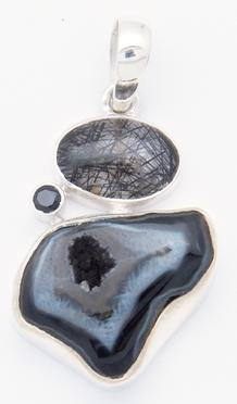 photo of black agate geode and 925 sterling silver pendant with tourmalated quartz and faceted black onyx