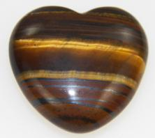 Photo of Tiger Iron puffy 30mm heart from Australia, made of gold tiger eye, hematite, brown and yellow jasper used for vitality, confidence, motivation, grounding