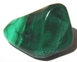"Photo of tumbled malachite from Zaire, protects children, stone called ""mirror of the soul"", copper mineral, also found in Congo"