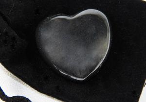 photo of shiny hematite puffy heart, pocket stone, with velour bag and info card, metaphysical crystal