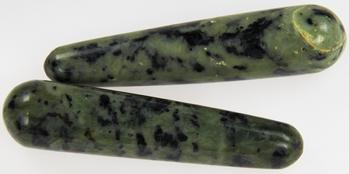 Photo of two massage wands made of green and black nephrite INCA jade from Peru