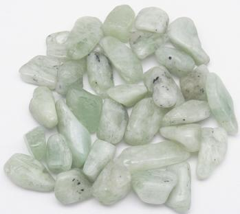photo of tumbled yellow green hiddenite from Nigeria Sister's Rocks LLC