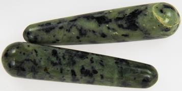 Photo of massage wands made of INCA jade which is a mixture of black and green nephrite jade from Peru