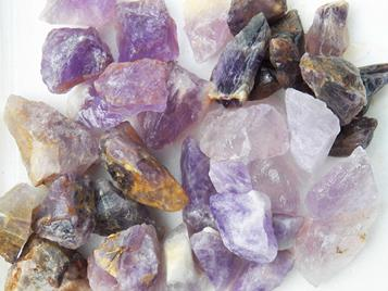 photo of amethyst from bolivia, brazil, india, madagascar, and mozambique rough rock for tumbling tumbler crystals