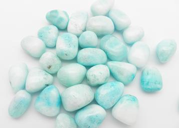 Photo of tumbled blue aragonite from China
