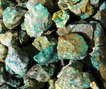 photo of rough tumbling rock chrysocolla from madagascar, a secondary mineral from oxidation level of copper
