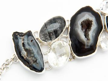 photo of black agate geode and 925 sterling silver bracelet with tourmalated quartz and faceted crystal quartz
