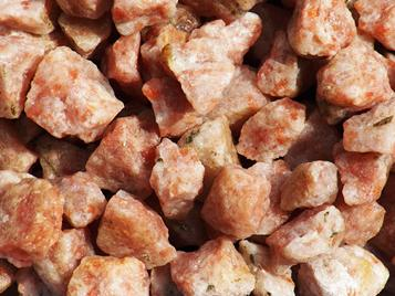 Photo of Sunstone from India, rough tumbling rock crystals