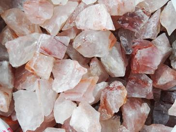Photo of red hematoid fire quartz rough rock for tumbling